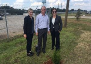 Biobased Maine's Charlotte Mace, Steve Schley (Biobased Maine Director and Maine Forest Economy Growth Initiative Board Chair), and Ashley Pringle of Maine and Co. planting a tree at API's Integrated Biorefinery in Thomaston, GA.