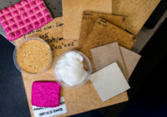 Prototypes of products made from wood nanocellulose at the University of Maine include an alternative to traditional drywall, formaldehyde-free particle board, and a scratch-, fire-, and water-resistant flooring system. (Photo courtesy of the University of Maine)